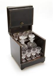 Sale 8202A - Lot 62 - An antique French brass bound Napoleon III decanter set, including eight shot glasses and two decanters, some wear to edges on case