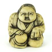 Sale 8304A - Lot 33 - Ivory Carved Erotic Netsuke of a Kneeling Lady