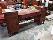 Sale 9085 - Lot 1071 - George III Mahogany Sideboard, the bow front sunken centre section fitted with two drawers & shaped back, raised on two pedestals wi...