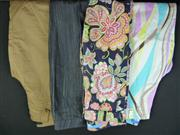 Sale 7982B - Lot 13 - Four pairs of Escada pants; one floral print (36), one optical pattern (36), one dark denim (34) and one sleek tan 3/4 length pant (34)