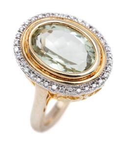 Sale 9194 - Lot 530 - A SILVER GILT STONE SET COCKTAIL RING; featuring an oval cut green amethyst of approx. 4.70ct to surround set with white zirconias,...