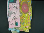 Sale 7982B - Lot 60 - Two pairs of colourful Valentino denim jeans; grafitti pait (6), floral print (27)