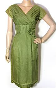 Sale 8173F - Lot 386 - A LATE 1950S CONNI CONN GREEN SILK DRESS; by Pagra Sydney SSW, some damage on shoulders.