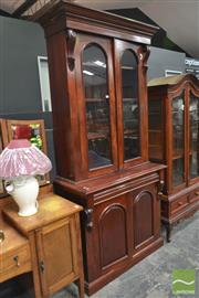 Sale 8277 - Lot 1010 - Timber Bookcase with Two Glass Panel Doors Above Two Drawers & Doors