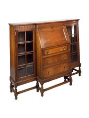 Sale 8379A - Lot 26 - An English vintage oak breakfront secretaire bookcase circa 1920s  H: 116cm W: 142cm D: 45cm