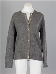 Sale 8661F - Lot 88 - A Braemar Scottish shetland wool knitted cardigan with gold toned buttons, 107cm