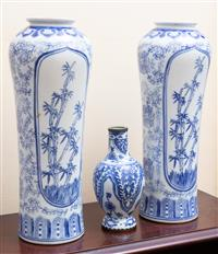 Sale 8735 - Lot 70 - A pair of rouleau blue and white Chinese vases with bamboo cartouche together with a metal mounted blue and white bottle vase of dim...