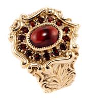 Sale 8899 - Lot 386 - A VICTORIAN STYLE GARNET CLUSTER RING; shield shape set with a cabochon and round cut garnets in 9ct gold, size O.