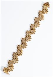 Sale 8960J - Lot 50 - A heavy vintage 18ct gold bracelet C: 1992, each sectional link of pierced bark design, the box clasp with registered makers plaque...