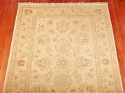 Sale 9081H - Lot 17 - An Afghan chobi rug with turquoise motifs on a pastel yellow ground, 147cm x 106cm