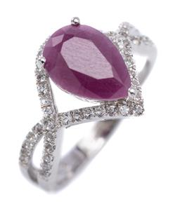 Sale 9194 - Lot 503 - A SILVER RUBY AND STONE SET RING; claw set with a pear cut ruby of approx. 2ct to bypass surround and split shoulders set with zirco...