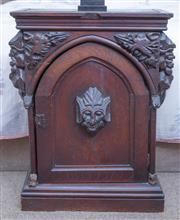 Sale 8800 - Lot 165 - An early oak single door priests cupboard, possibly C17th, with carved mask and arched door H 72 x W 54 x D28cm