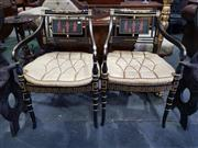 Sale 8814 - Lot 1044 - Pair of Early 19th Century Style Ebonised, Gilt & Painted Armchairs, with cane seats, Greek revival painted panels and loose button...