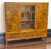 Sale 8222 - Lot 83 - A 1920s timber veneered quality three door book case, with central glazed door, outer doors inlaid with urns, H 145, W 148, D 43cmR...