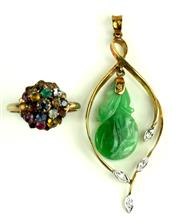 Sale 8315 - Lot 306 - TWO GOLD GEMSTONE ITEMS;  a 14ct pendant with articulating green jadeite carving above 4 round brilliant cut diamonds, length 52mm a...