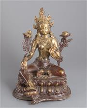 Sale 8536 - Lot 36 - 18th/19th century Tibetan gilt bronze figure of Tara seated in lalitasana on a double-lotus base with her pendant leg resting on an...