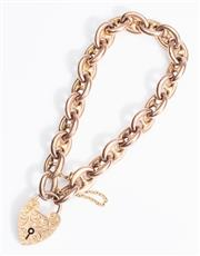 Sale 8960J - Lot 52 - An antique 9ct rose gold fancy link bracelet, Birmingham 1905, the large heart shaped padlock clasp beautifully hand engraved with f...