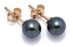 Sale 9160 - Lot 325 - A PAIR OF PEARL STUD EARRINGS; 6.61mm round cultured black pearls of good colour and lustre to 9ct gold fittings.