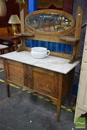 Sale 8550 - Lot 1267 - Early C20th Oak Washstand with oval mirror above tiled back and marble top; together with a Grindley basin