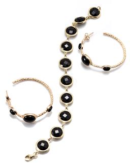 Sale 9168J - Lot 311 - SILVER GILT ONYX HOOP EARRINGS AND BRACELET; textured earrings set with cabachon oval onyx to stud fittings, length 40mm, and bracel...