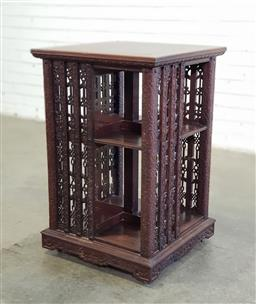 Sale 9196 - Lot 1018 - Early 20th Century Chinese Carved Fruitwood Revolving Bookcase, on castors and NOT a swivel stand, the uprights pierced with flora...