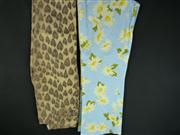 Sale 7982B - Lot 130 - Two pairs of Moschino pants; Moschino Cheap and Chic floral denim (USA 8), Moschino Jeans heart leaopard print (Size 28)