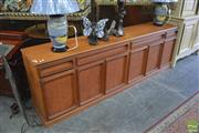 Sale 8409 - Lot 1692 - Chiswell Sideboard with Four Drawers Above Six Doors