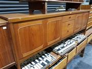 Sale 8765 - Lot 1023 - Nathan Teak Sideboard with 3 Central Drawers and 4 Doors