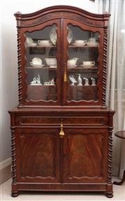 Sale 8881H - Lot 20 - A mahogany secretaire cupboard with two glass doors opening to reveal shelves and drawers. The base with writing desk pull out area...