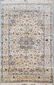 Sale 8882 - Lot 1092 - Nain Wool Carpet, with floral arabesques in cream & blue tones 260 x 158 cm