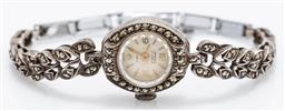 Sale 9180E - Lot 46 - A Swiss made Iposa 17 jewels incabloc ladys wristwatch with marcasites