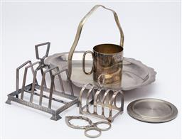 Sale 9099 - Lot 205 - A small collection of silver plated wares including two toast racks, egg piercer, handled tray, and others