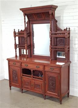 Sale 9215 - Lot 1052 - Victorian Aesthetic Style Carved Walnut Sideboard, the high mirror back flanked by a deep cavetto pelmet & shelves with floral carve...