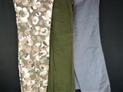 Sale 7982B - Lot 131 - Three pairs of Moschino Jeans; floral camo print (USA 8), army green (USA 10), dark blue denim (30)