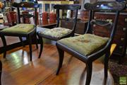 Sale 8520 - Lot 1025 - Pair of Regency Mahogany Chairs, with carved back rails inlaid in brass, with drop in seats & sabre legs TOGETHER with another simil...