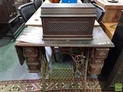Sale 8550 - Lot 1489 - Vintage Singer Sewing Machine in Cabinet