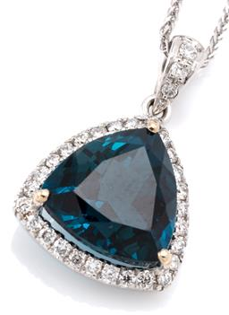 Sale 9132 - Lot 441 - AN 18CT WHITE GOLD TOPAZ AND DIAMOND PENDANT NECKLACE; featuring a trillion cut 6.10ct London blue topaz to surround and bale set wi...