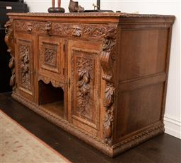 Sale 9160H - Lot 202 - An English gothic revival carved oak sideboard with zoomorphic masks, fruit and foliage carvings with frieze, panel and supports, wi...
