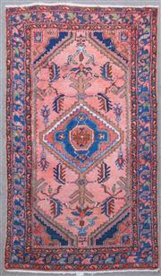 Sale 8800 - Lot 166 - A hand-knotted woolen Persian carpet, on salmon ground with lozenge central medallion, 155 x 90cm