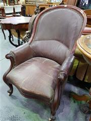 Sale 8653 - Lot 1074 - Victorian Mahogany Armchair, upholstered in brown leatherette, the arms lightly carved & on cabriole legs