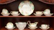 Sale 8881H - Lot 21 - A C19th English tea service by Rockingham, from the collection of Tolbat Sanderson, comprising six cups and saucers, milk jug, drip...