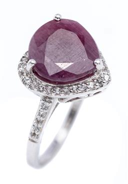 Sale 9194 - Lot 505 - A SILVER RUBY AND TOPAZ RING; heart shaped setting centring a pear cut ruby of approx. 3.48ct to surround and shoulders set with whi...