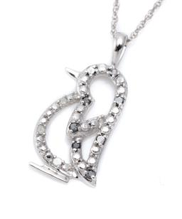 Sale 9186 - Lot 321 - A 10CT WHITE GOLD BLACK AND WHITE DIAMOND PENDANT NECKLACE; in the form of a penguin set with 3 white and 7 black single cut diamond...