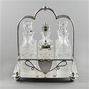 Sale 8444A - Lot 20 - An antique silverplate and hand cut lead crystal six bottle cruet set, c1910