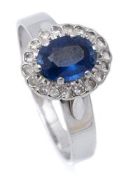 Sale 9020 - Lot 390 - A WHITE GOLD GEMSET CLUSTER RING; centring an oval cut synthetic blue sapphire surrounded by white sapphires on a 10ct basket mount...