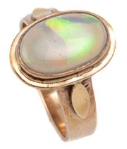 Sale 9020 - Lot 343 - A VINTAGE 9CT GOLD OPAL RING; rub set with a 13 x 8.5mm crystal opal to plain flat surround, size Q, wt. 5.3g.