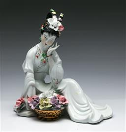 Sale 9156 - Lot 275 - Chinese White Glazed Porcelain Figure of a Maiden, with polychrome flowers and gilt accents, 26 cm H, 26 cm W