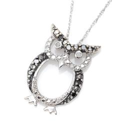 Sale 9186 - Lot 319 - A 10CT WHITE GOLD BLACK AND WHITE DIAMOND PENDANT NECKLACE; in the shape of an owl set with 4 white and 7 single cut black diamonds...