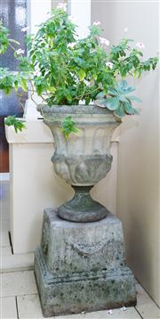 Sale 8308A - Lot 1 - A pair of classical style stone urns raised on tapered bases with foliage, each height 86cm.