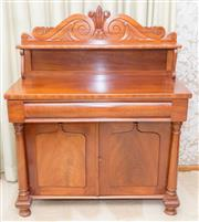 Sale 8346A - Lot 12 - An early Australian cedar chiffonier mid C19th with hope scroll carved back board and shelf single frieze shield panel doors with ac...